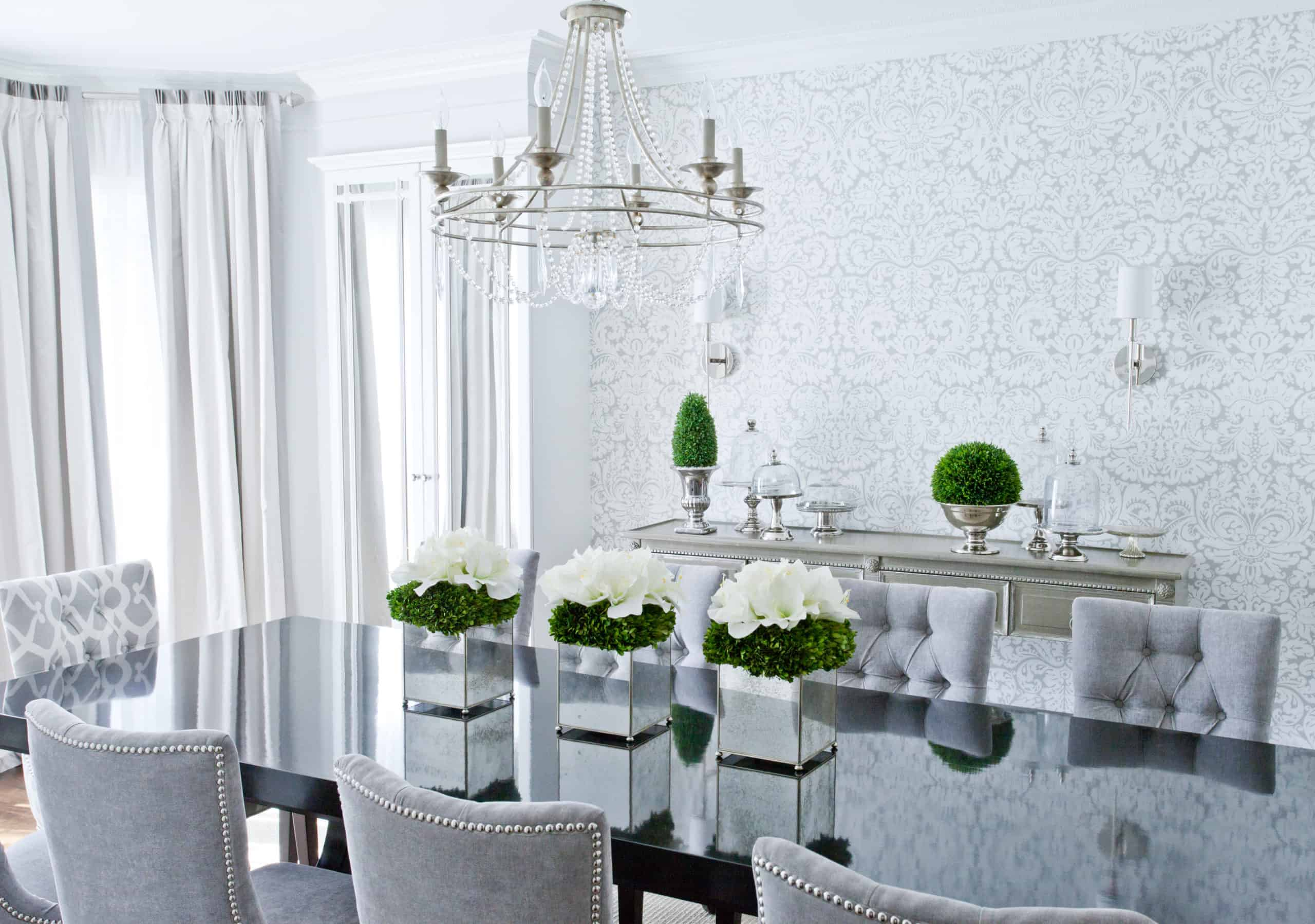 Dining room with a white and blue wallpaper