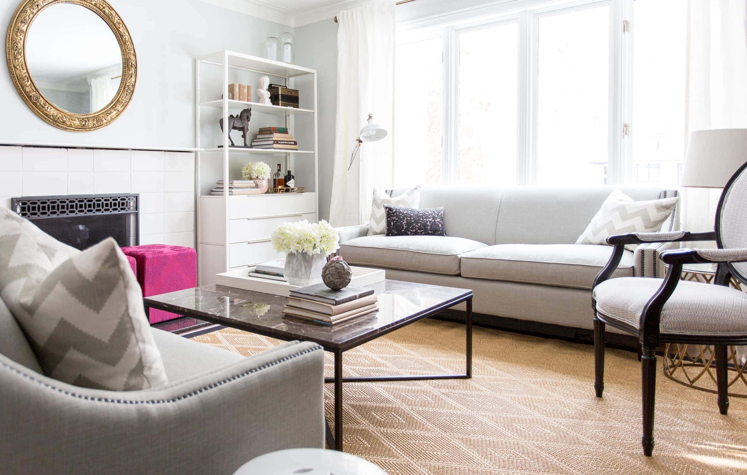 Large open living room with a focus on the glass coffee table