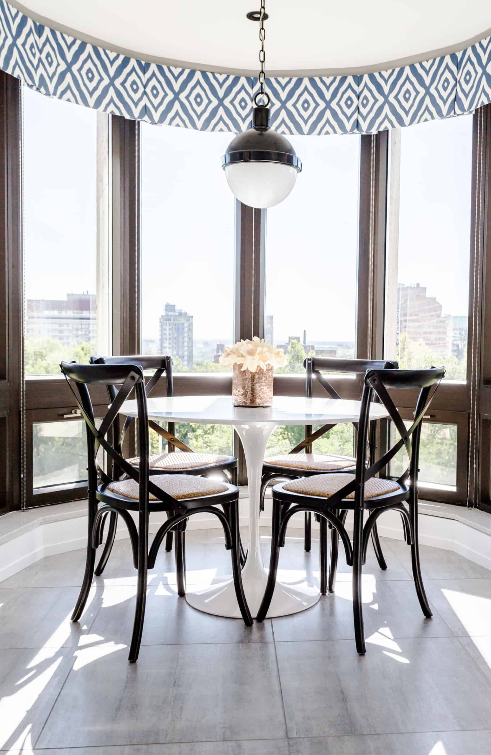 Small dining room with windows surrounding it