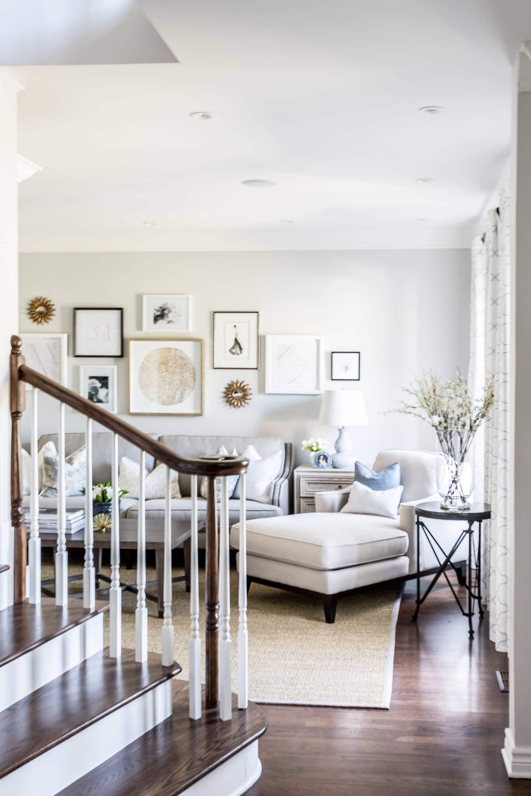 Bright living room next ti the staircase