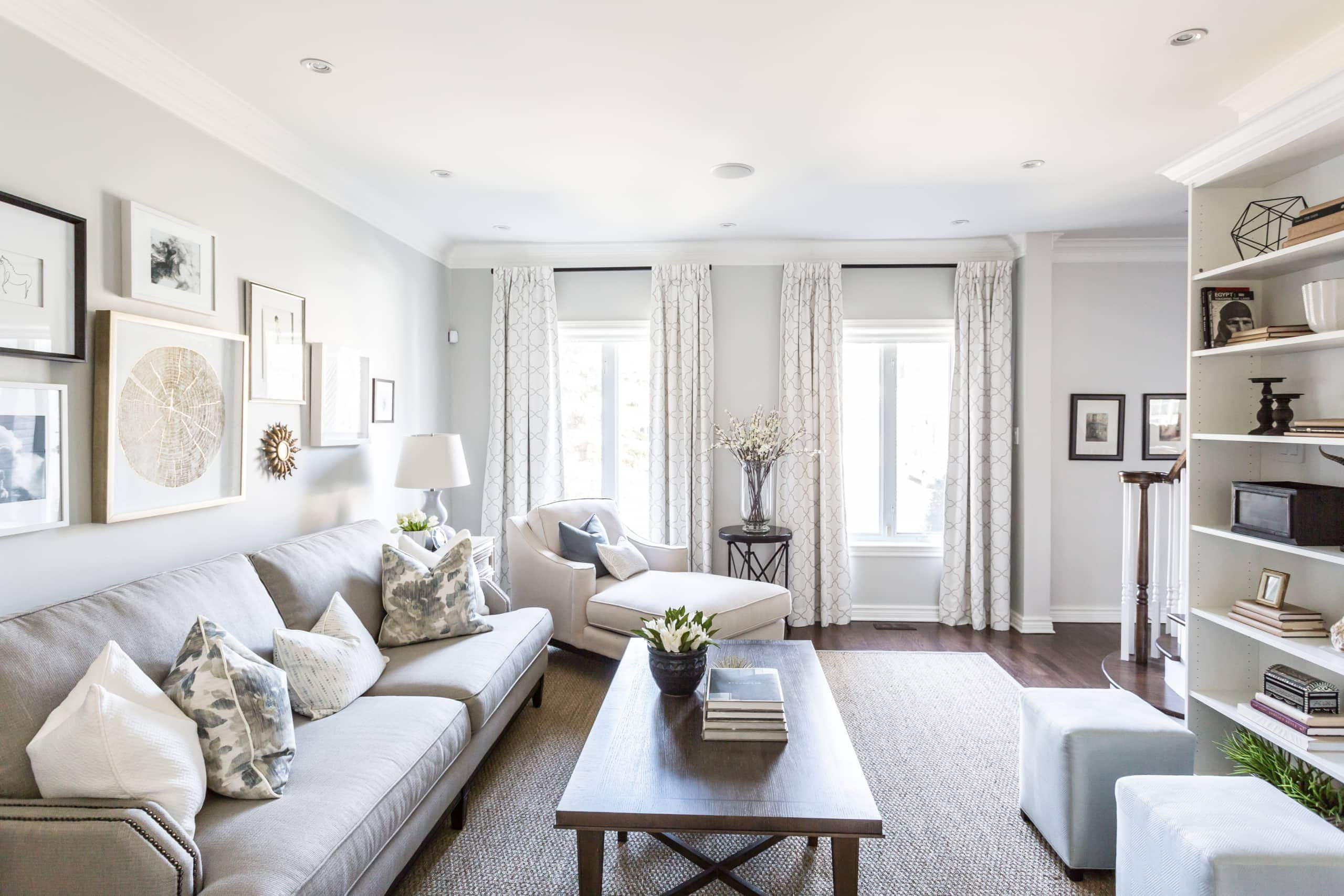 Bright, large living room with a focus on two windows