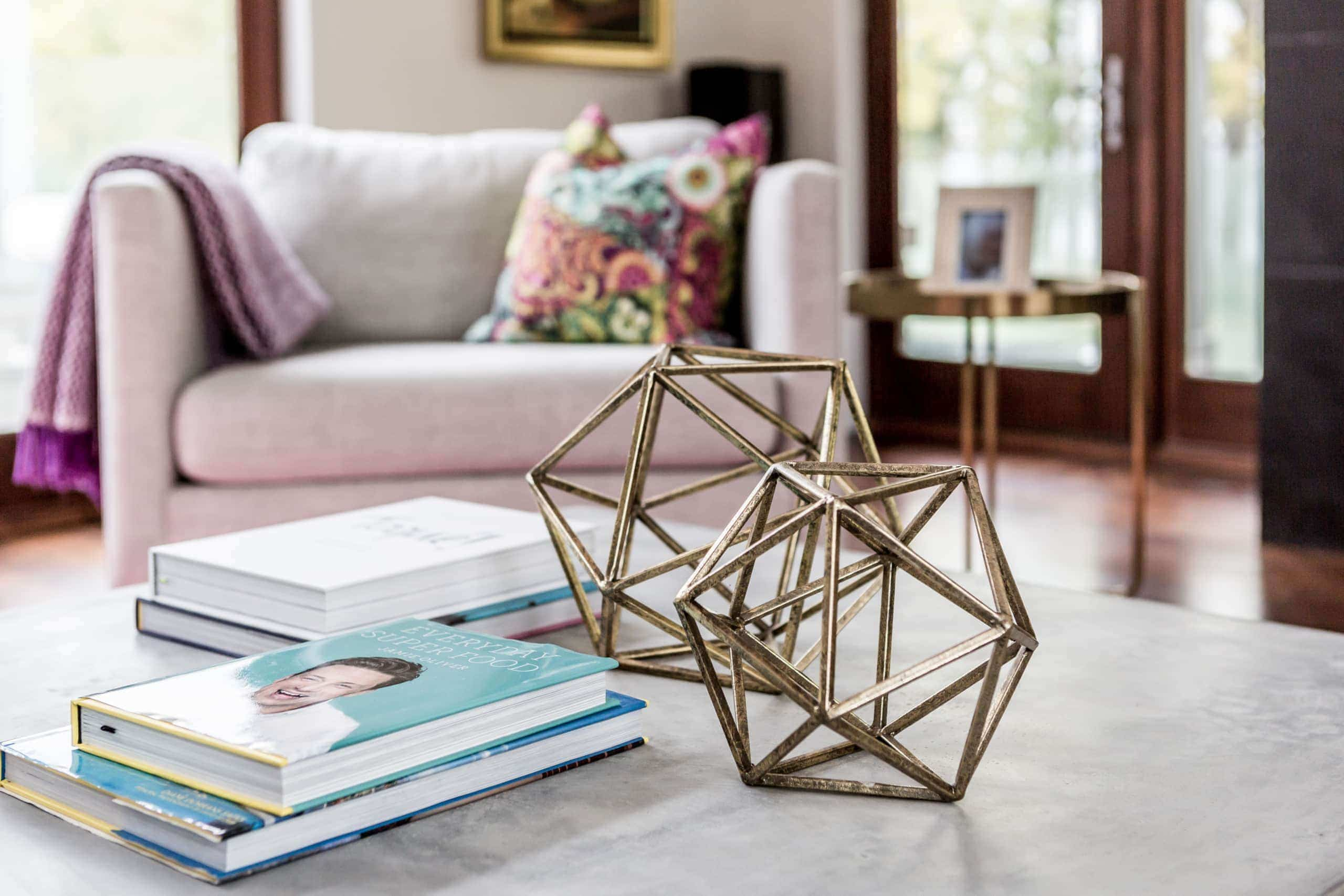 Gold colored polygonal decorations on a coffee table