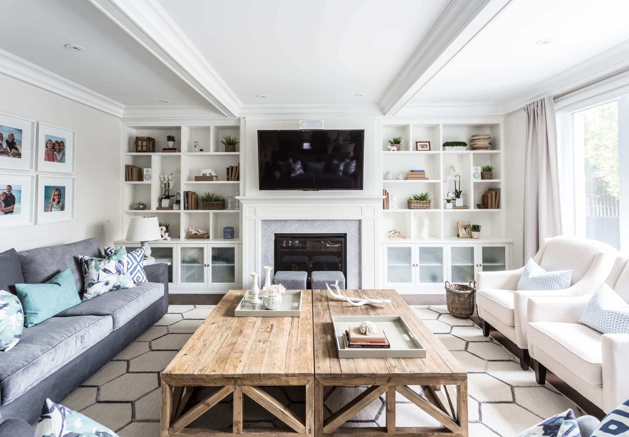 Television above the fireplace flanked by shelving units