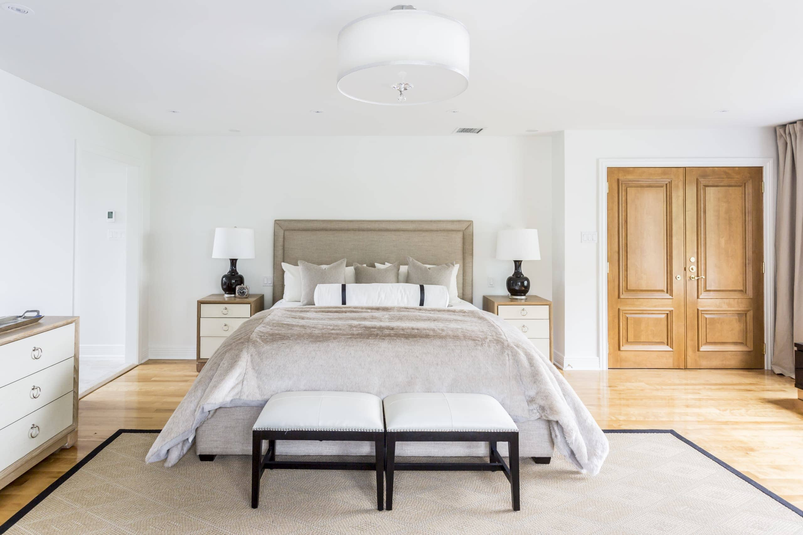Large bed with the same bedside table and lamps on each side within the master bedroom