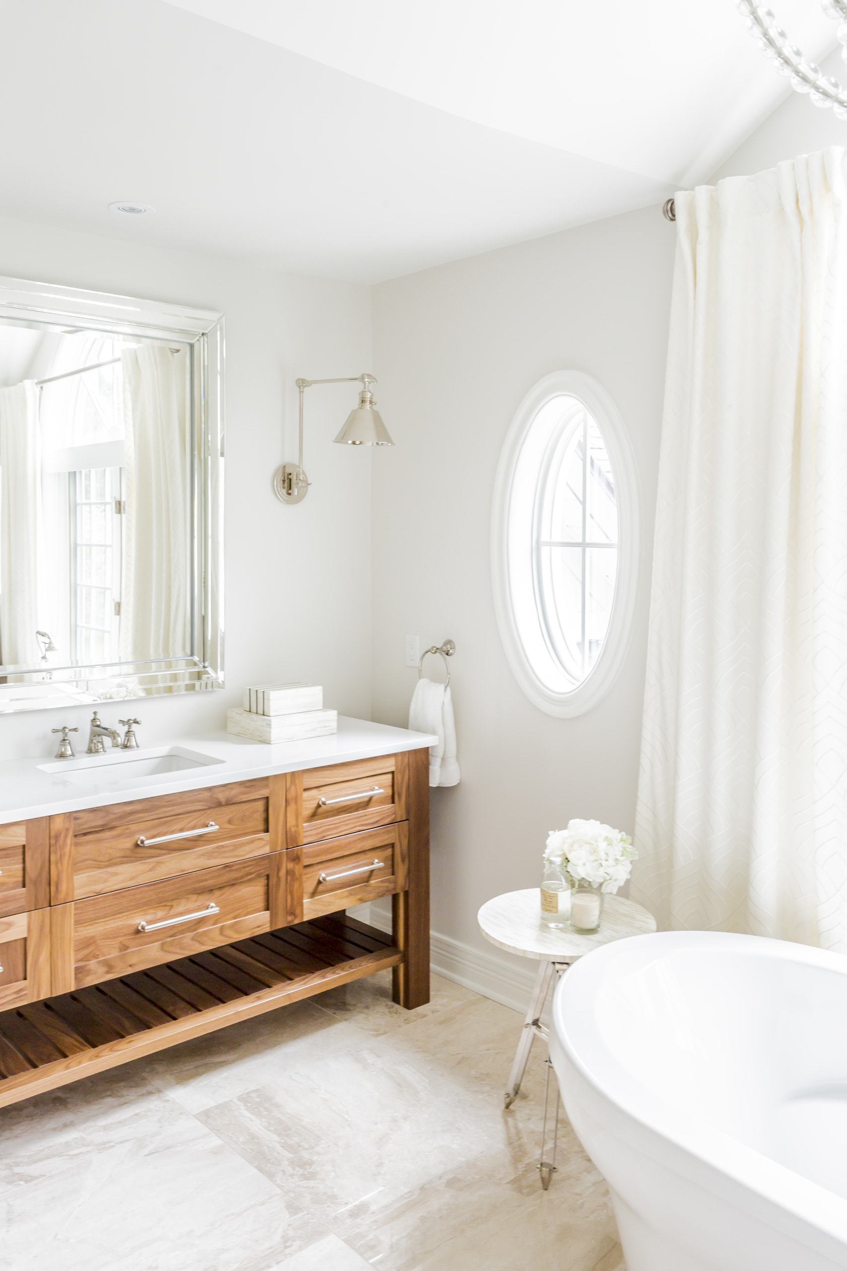 Clean, white bathroom with large double vanities