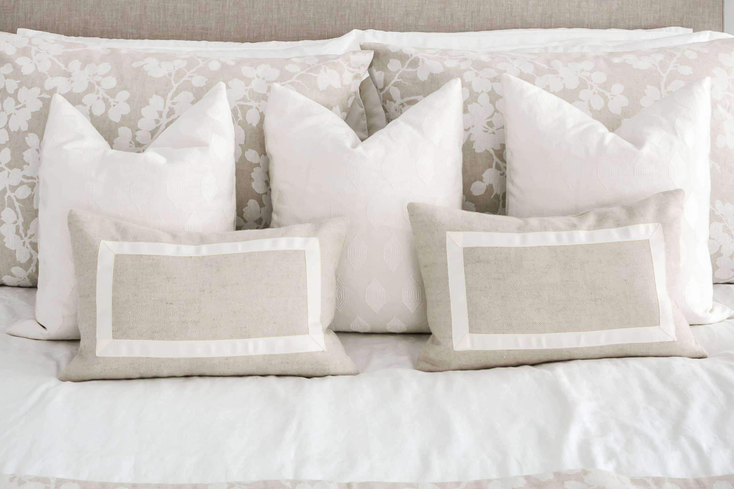 Array of pillows colored beige and white