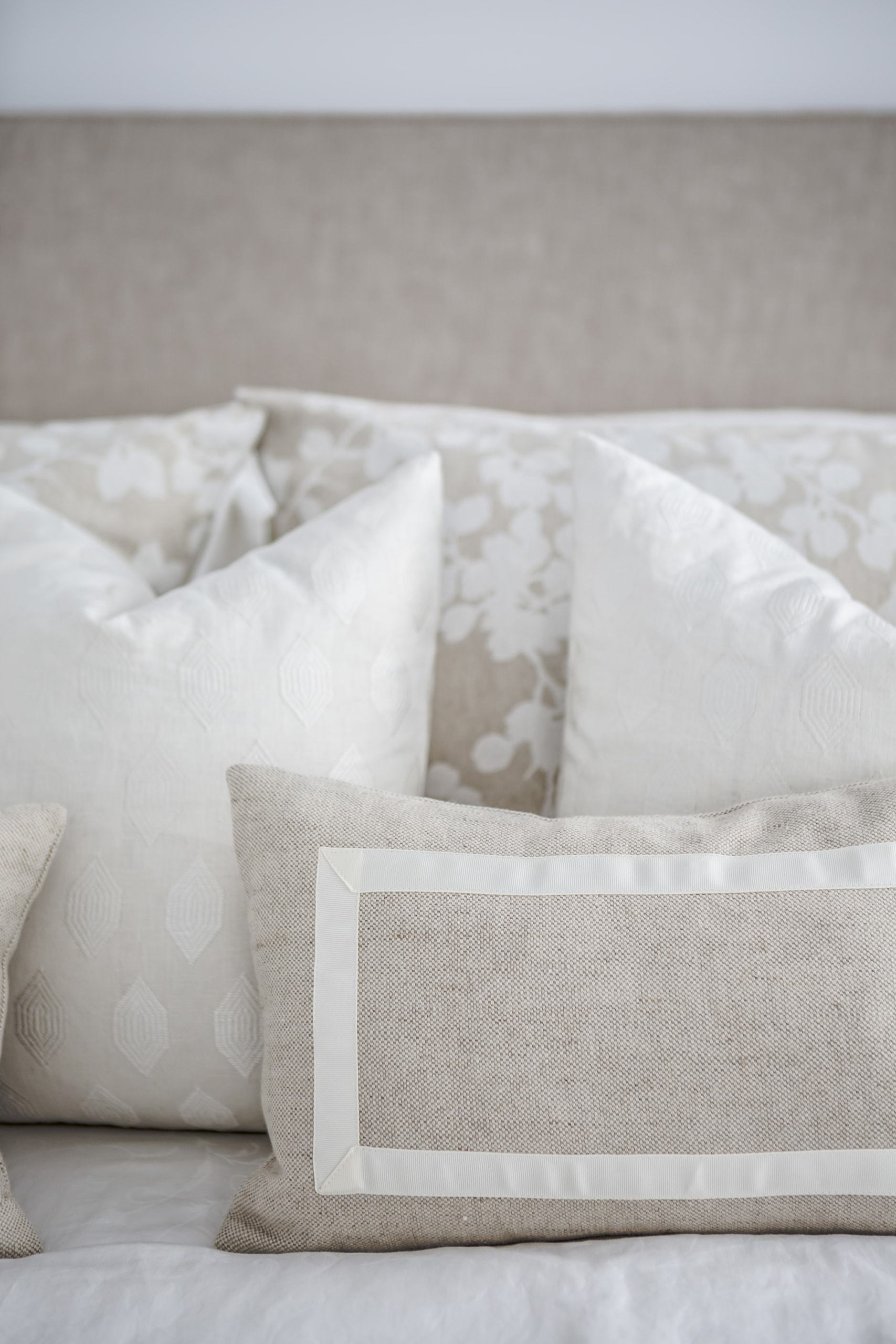 Array of white and beige pillows