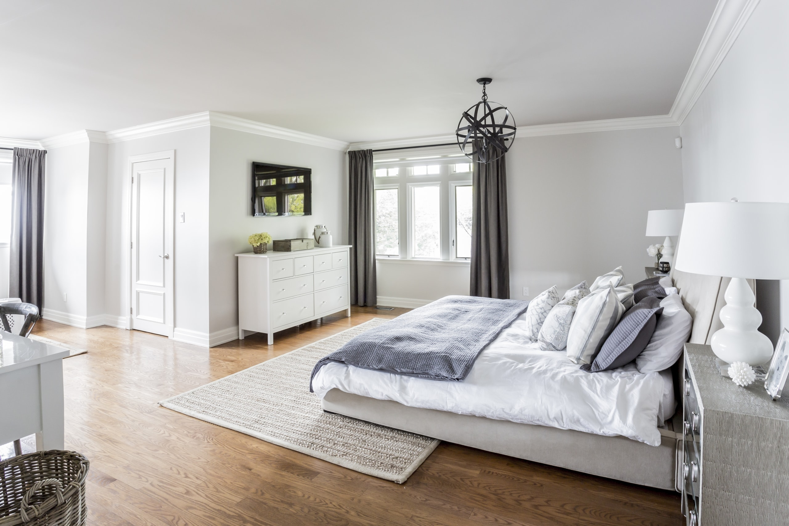 Large bed within a massive master bedroom