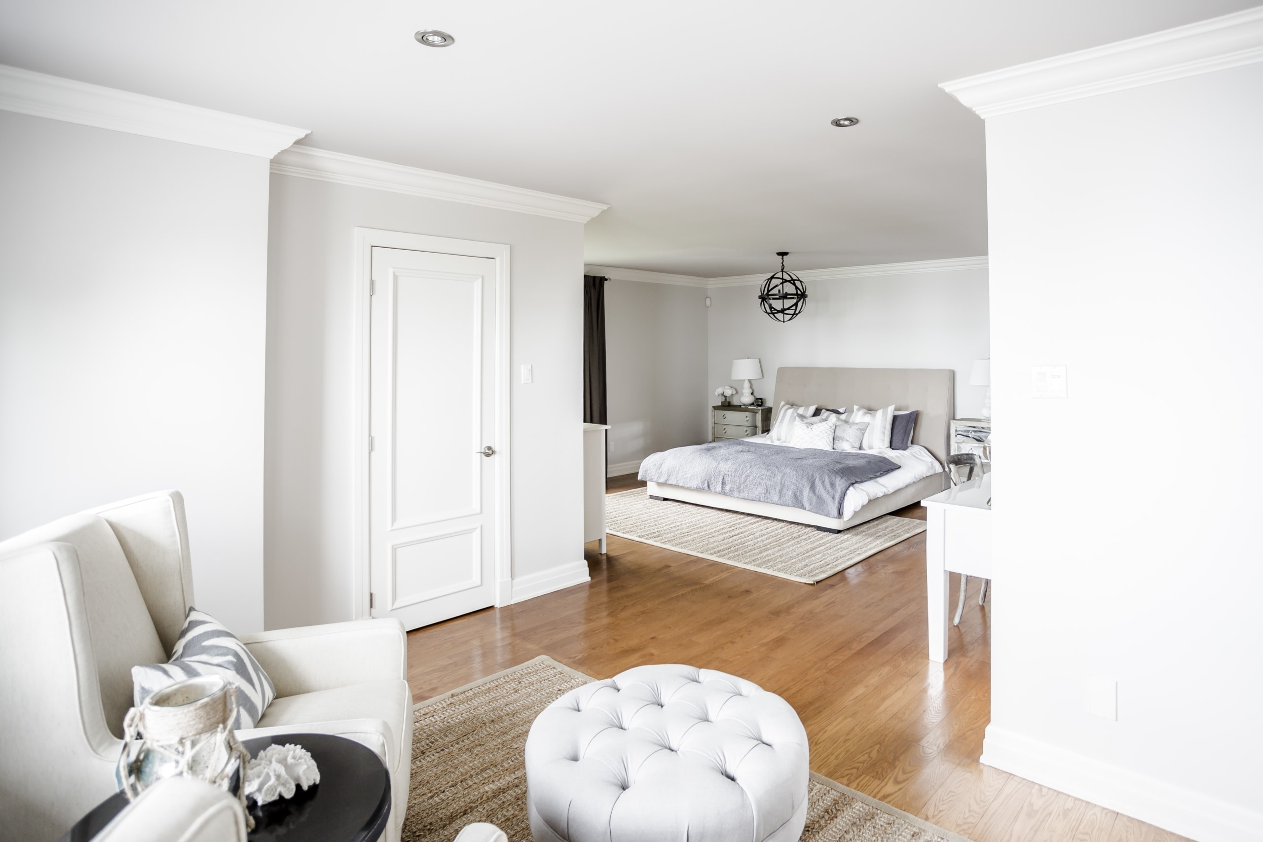 Massive master bedroom with a sitting area and bed area