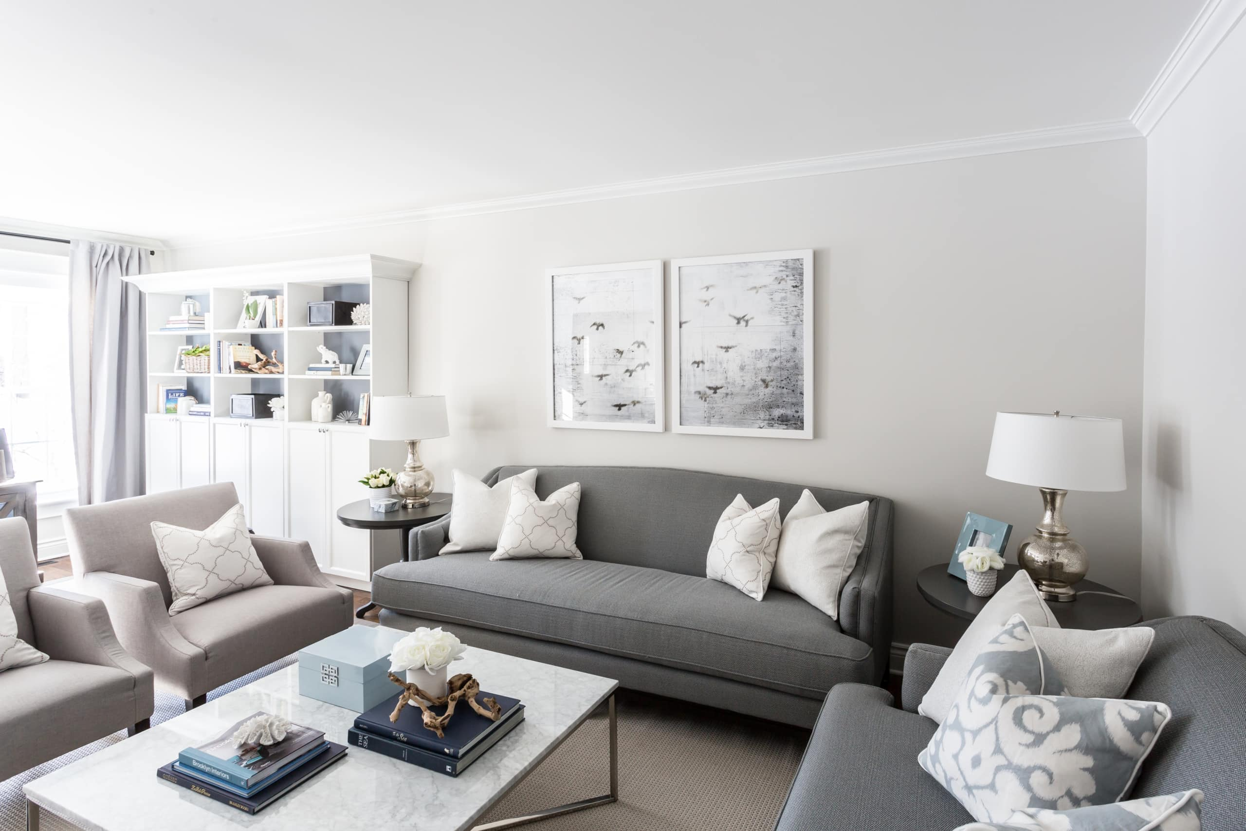 Gray couch with pictures behind it inside living room