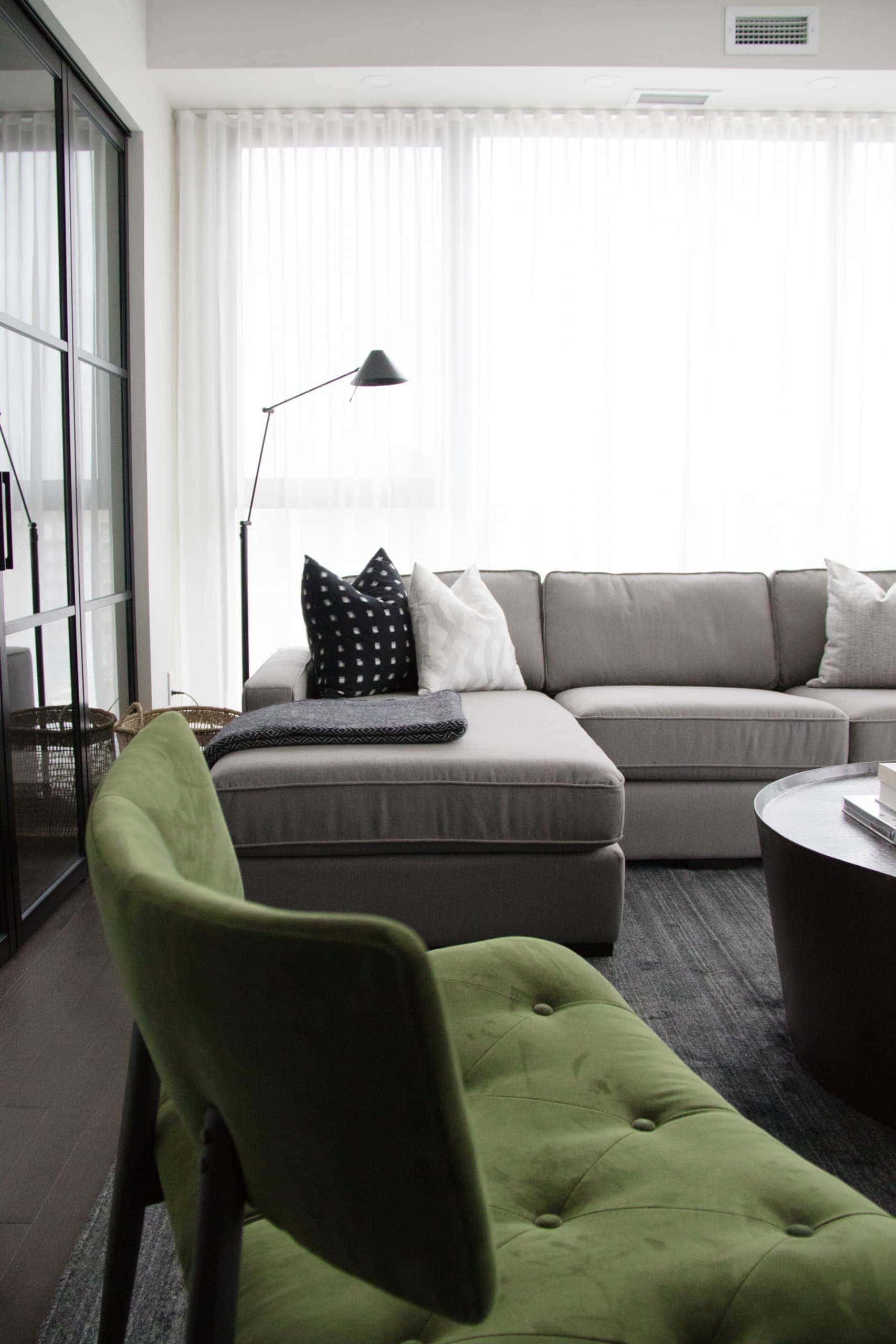 Modern living room with a green chair in the corner