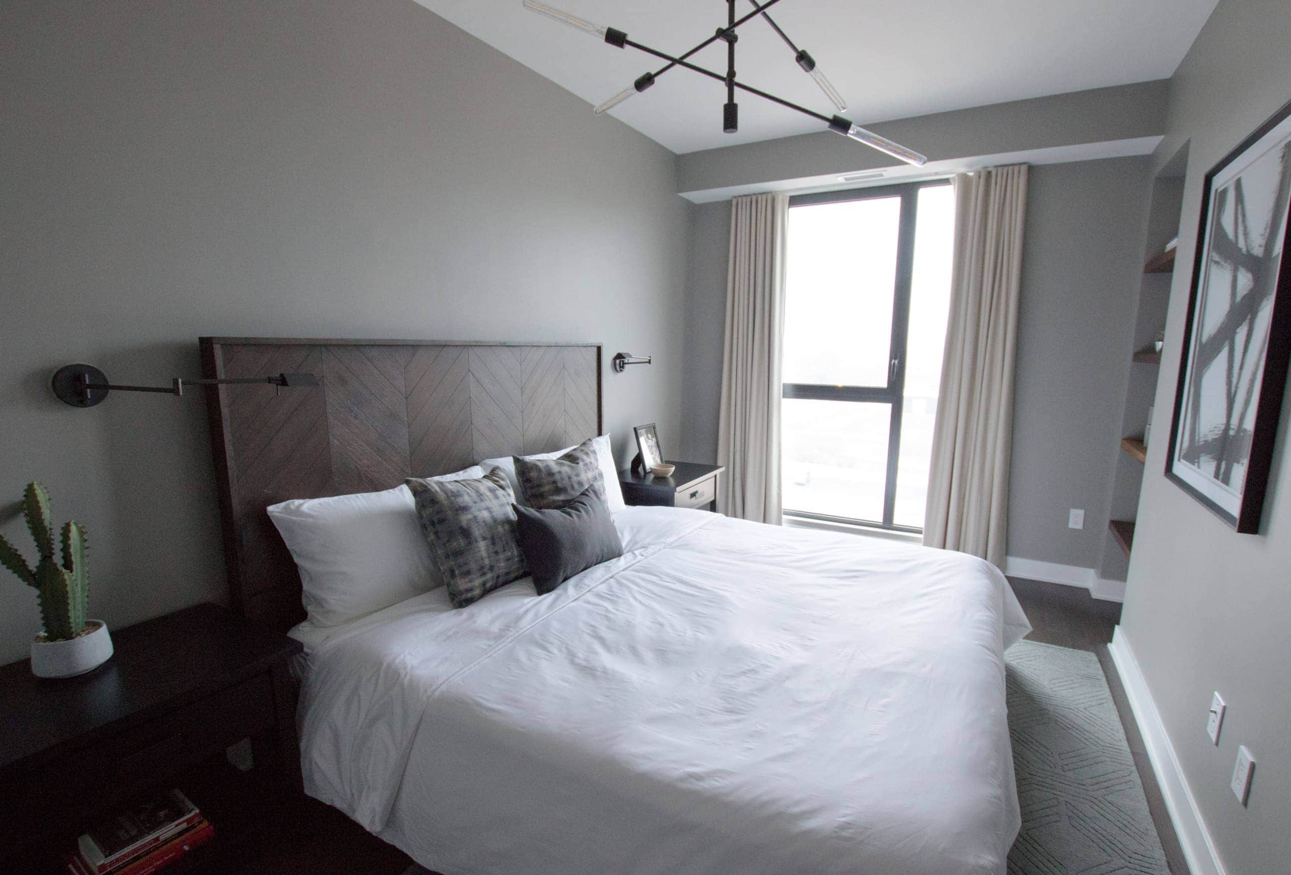 Large white bed with a wooden headboard