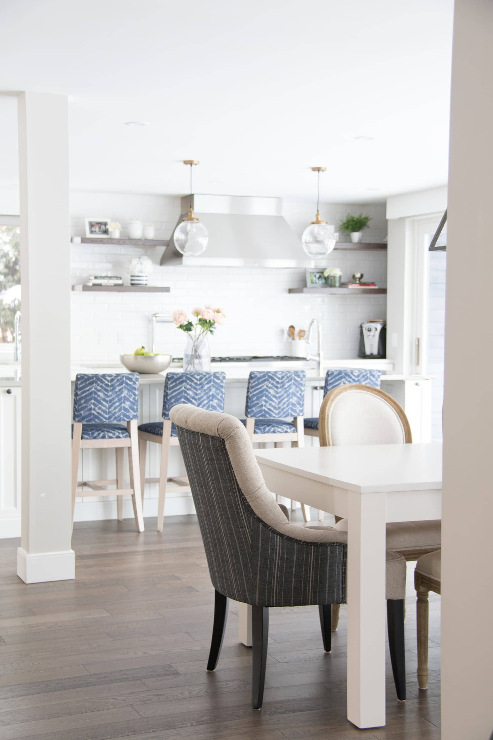Bright, modern kitchen with dining room table next to it