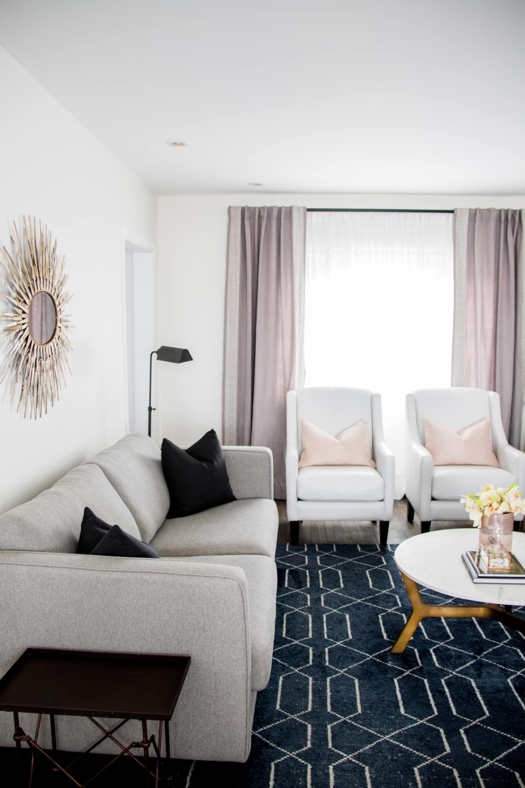 Bright living room with pink curtains