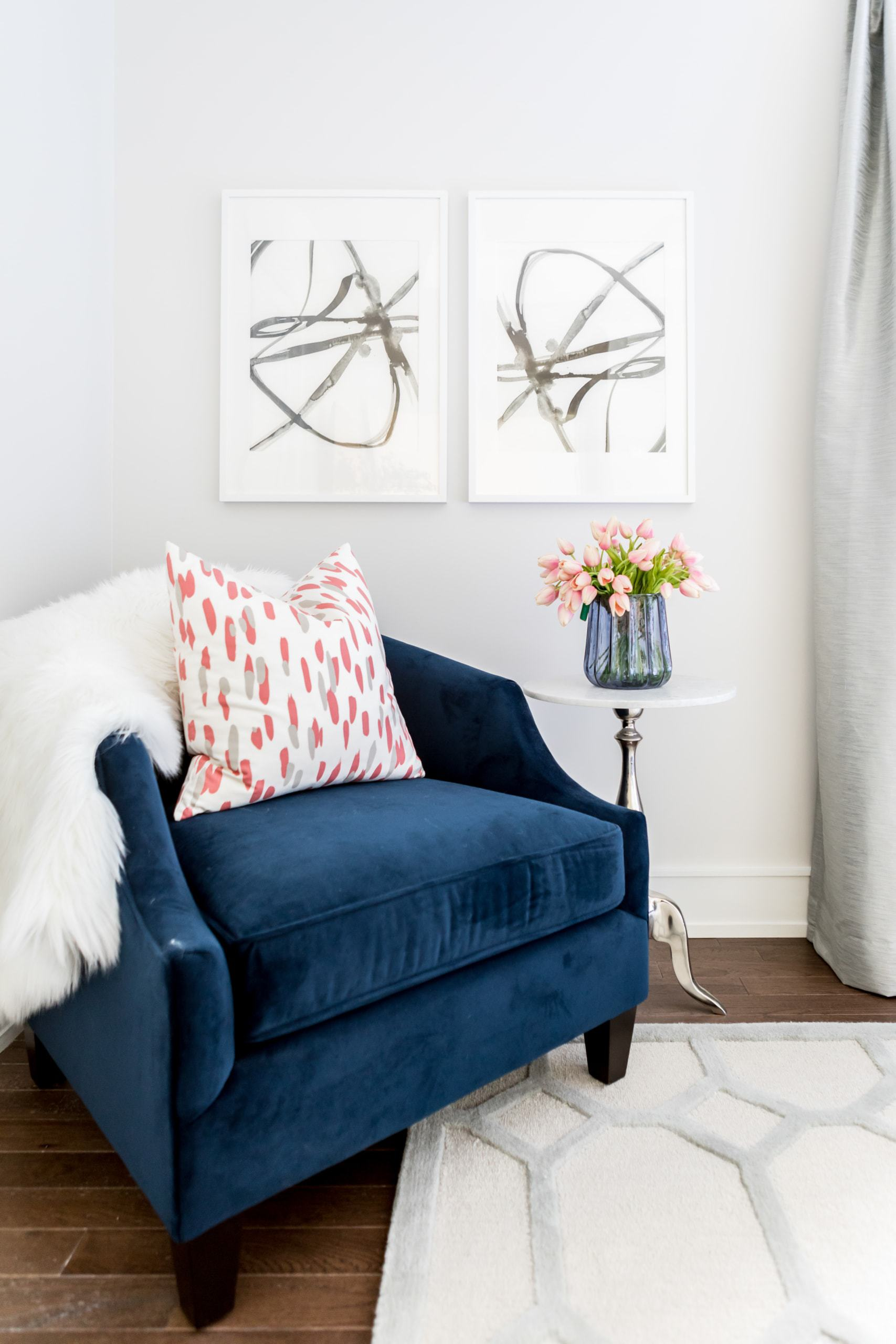 Blue chair in the corner of the master bedroom