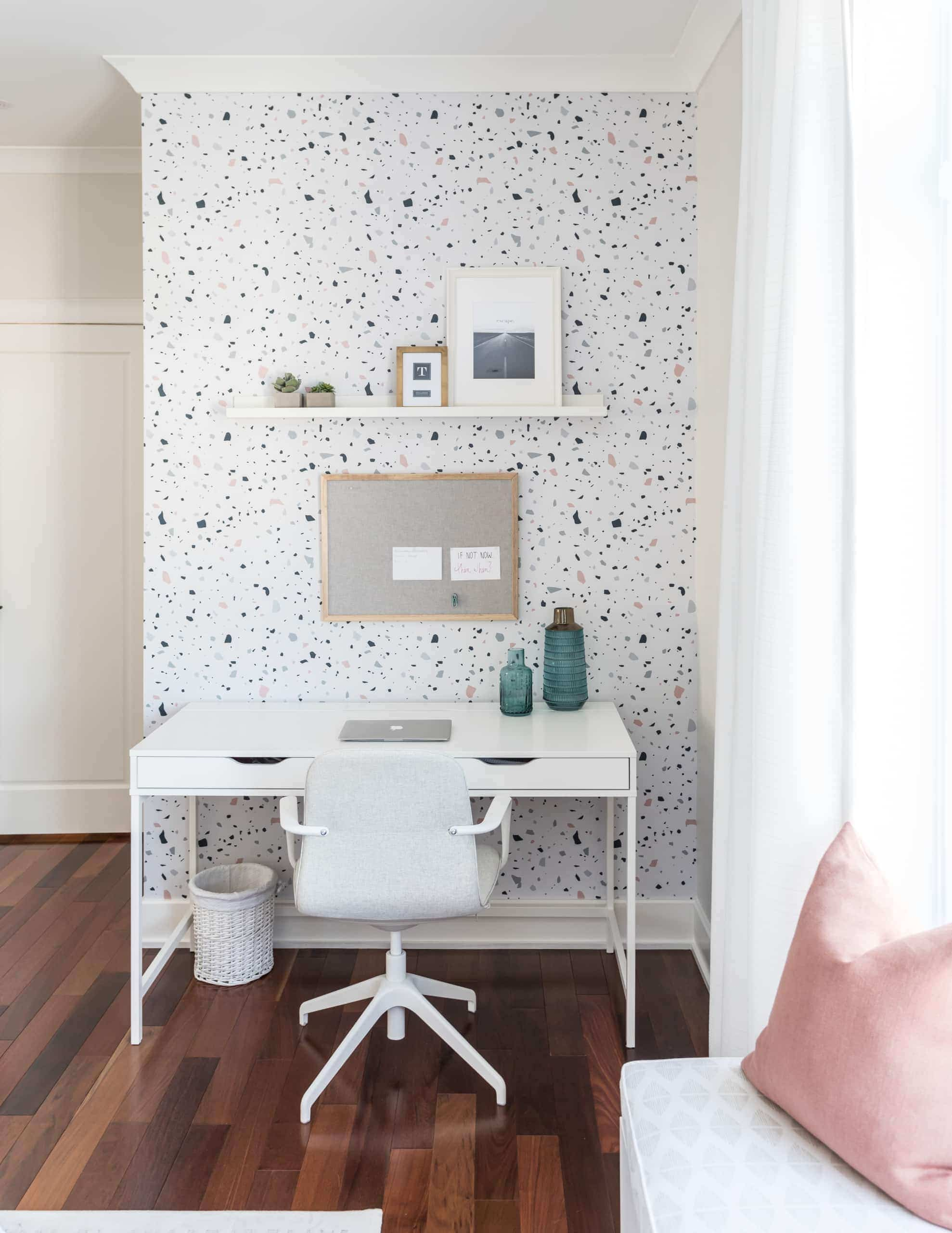 Small office space with a wallpaper on the wall