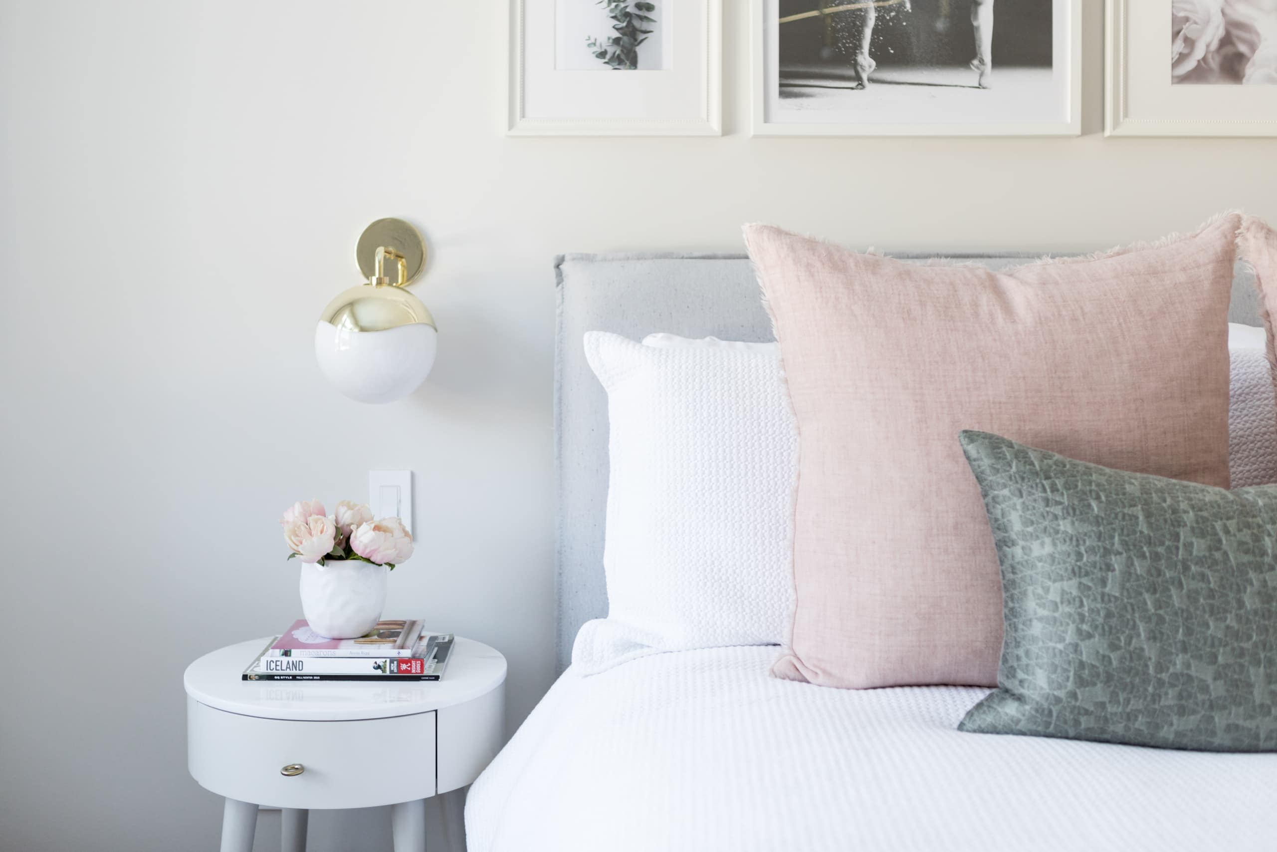 Bed side table next to large white bed