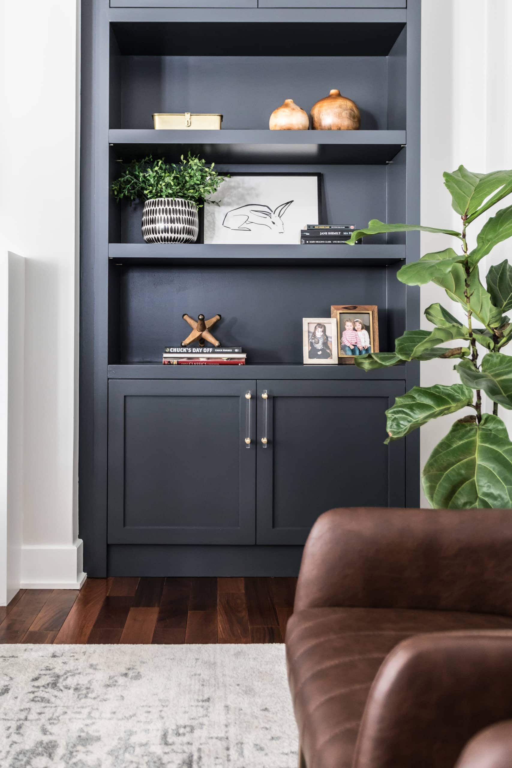 Blue bookcase next to fireplace