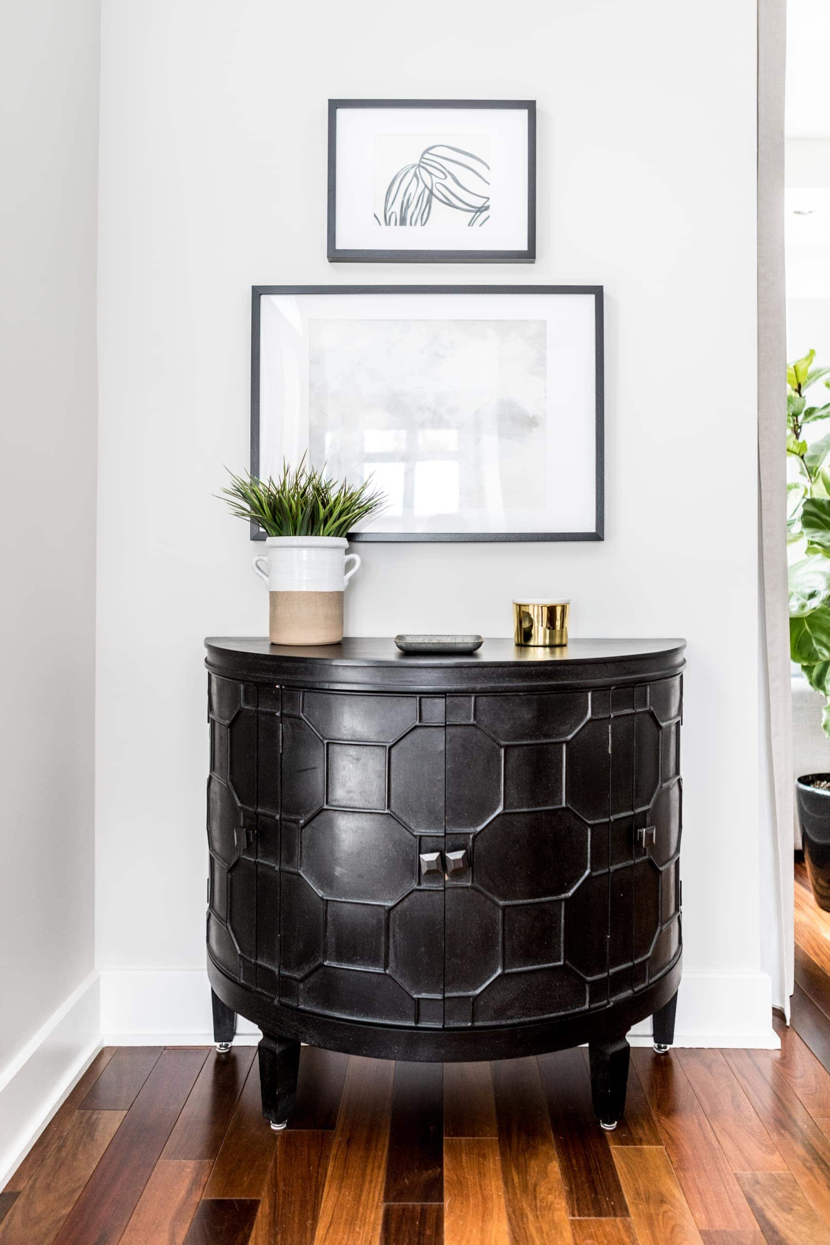 Black table against the wall near a staircase