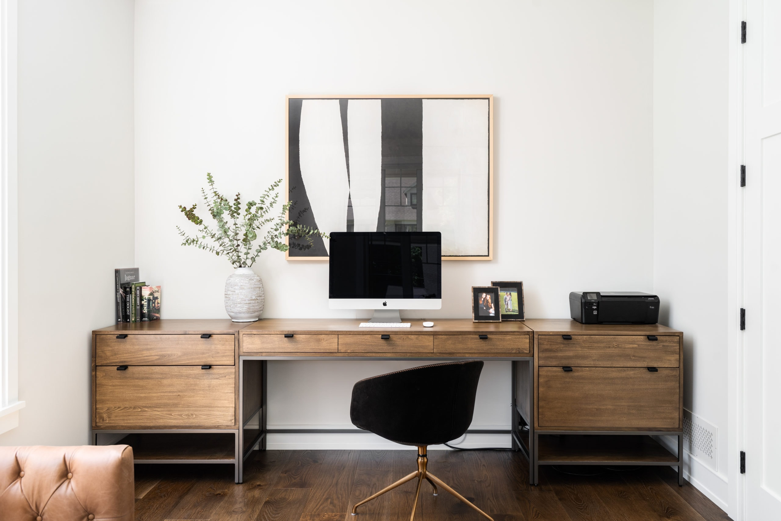 Modern wooden desk with an apple computer on it