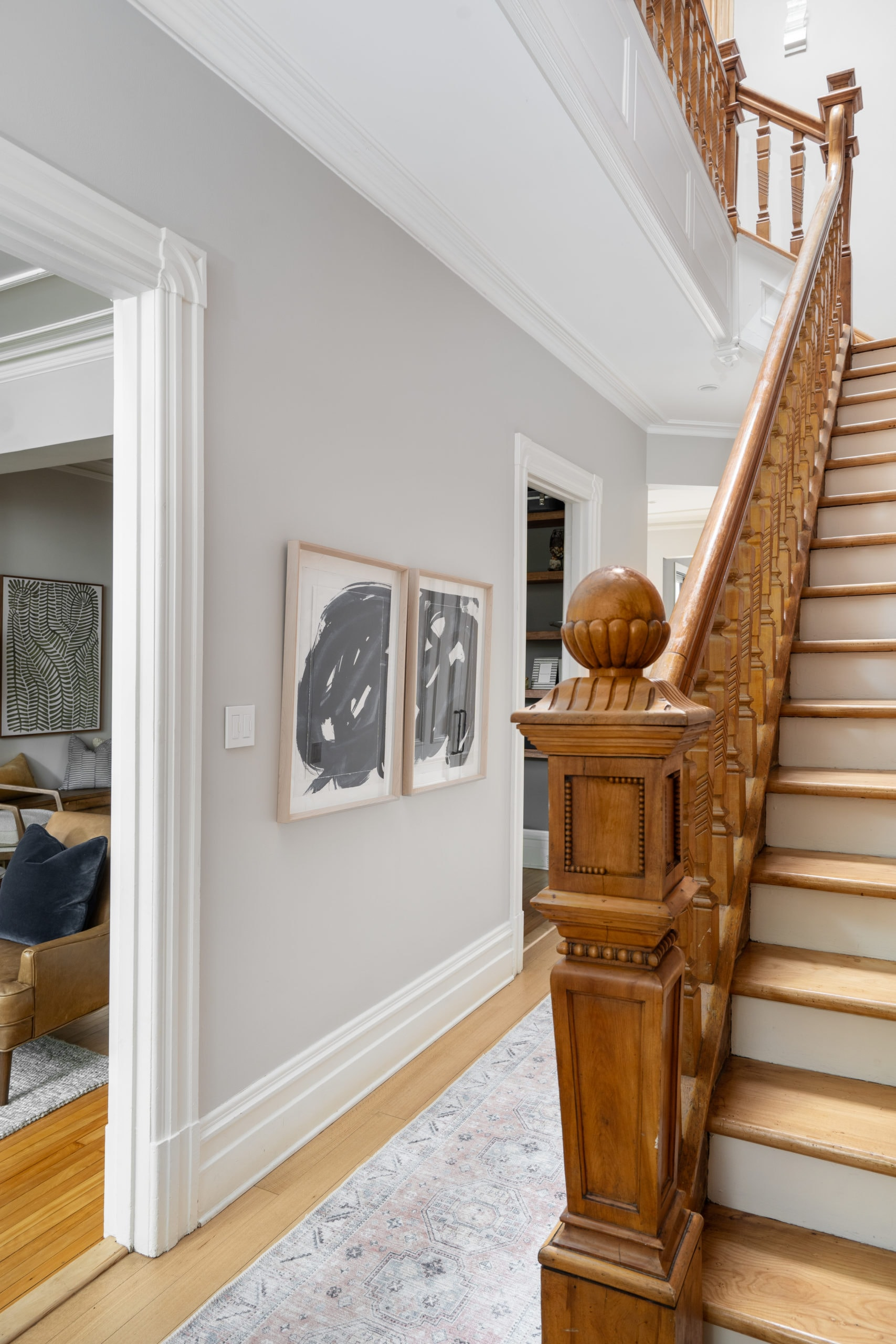 Staircase with a focus on the wooden handrail