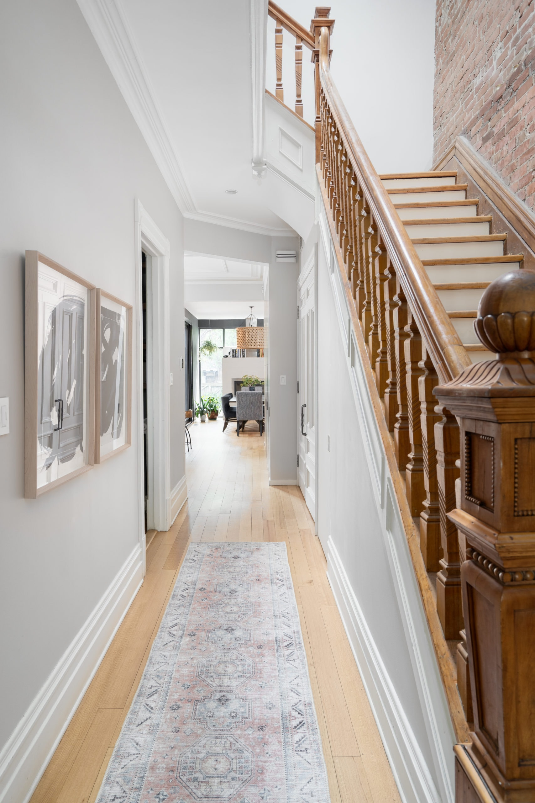Long hallway with a staircase next to it