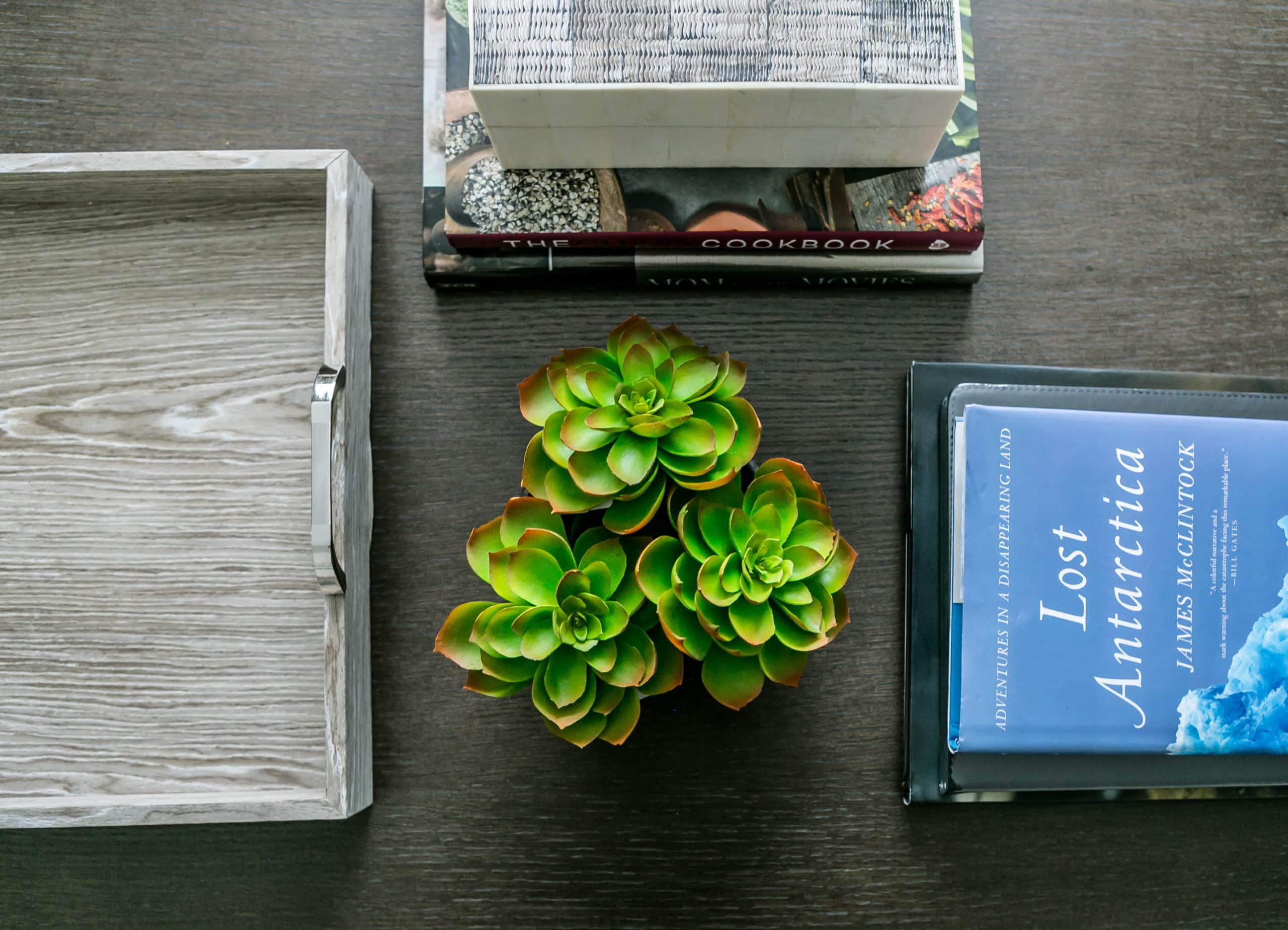 Books, flowers and a tray on a wooden table