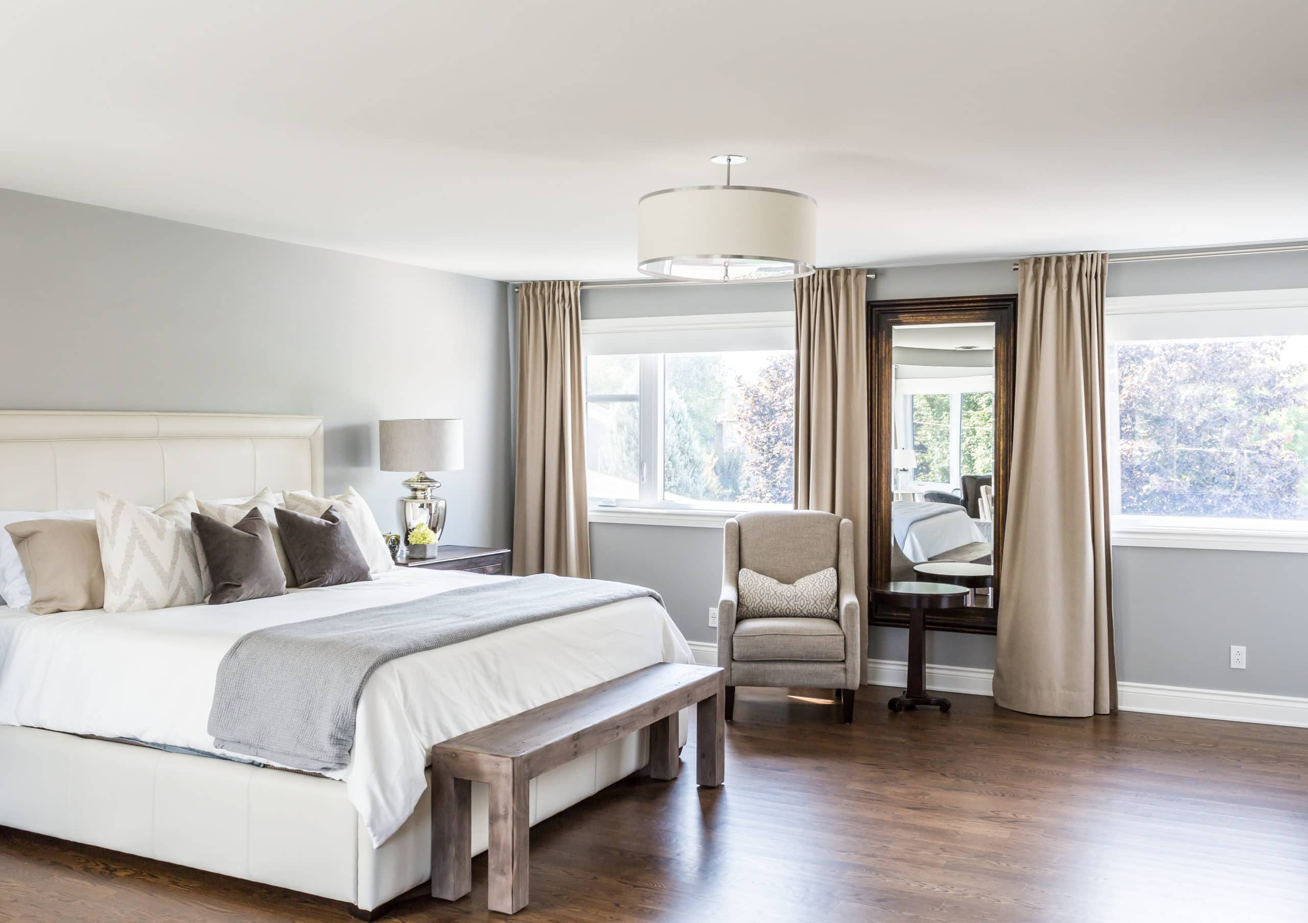 Large, modern master bedroom containing a large white bed