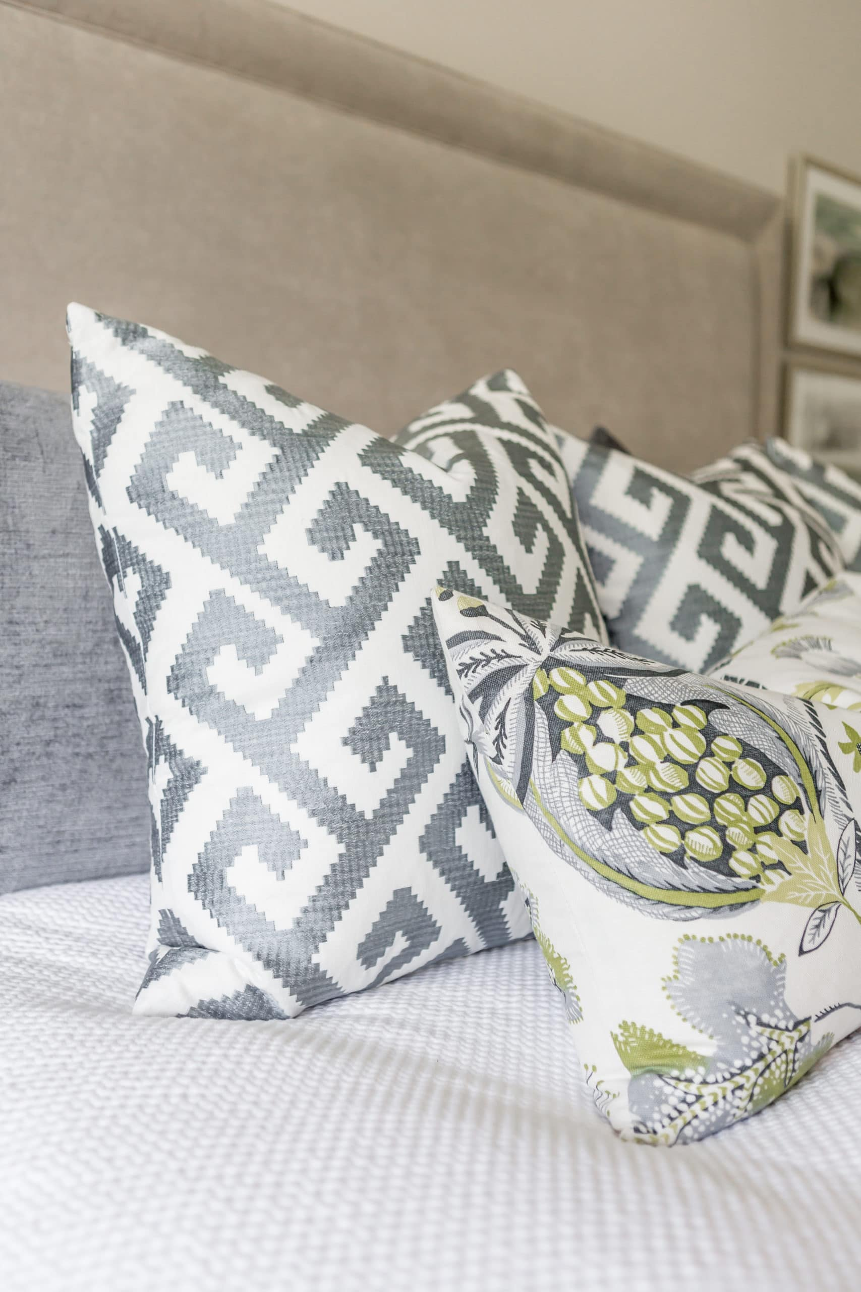 Patterned pillows on a bed
