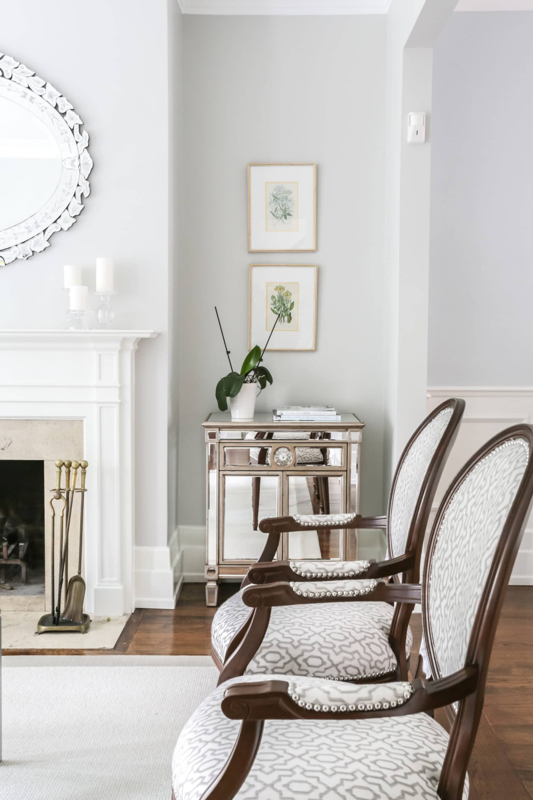 Two small beautiful chairs in a living room