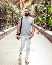 michael checkers street style madrid wearing white pants from Express