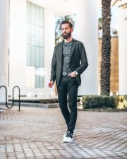Micheal Checkers wearing men's stretch jeans in Miami Beach, Florida Street Style