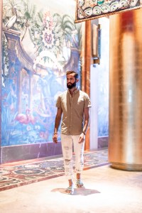 Michael Checkers wearing white jeans at Faena Miami Beach wide angel