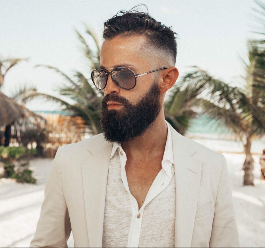 Michael Checkers headshot for Menswear Look 001 Tulum White Prada Suit