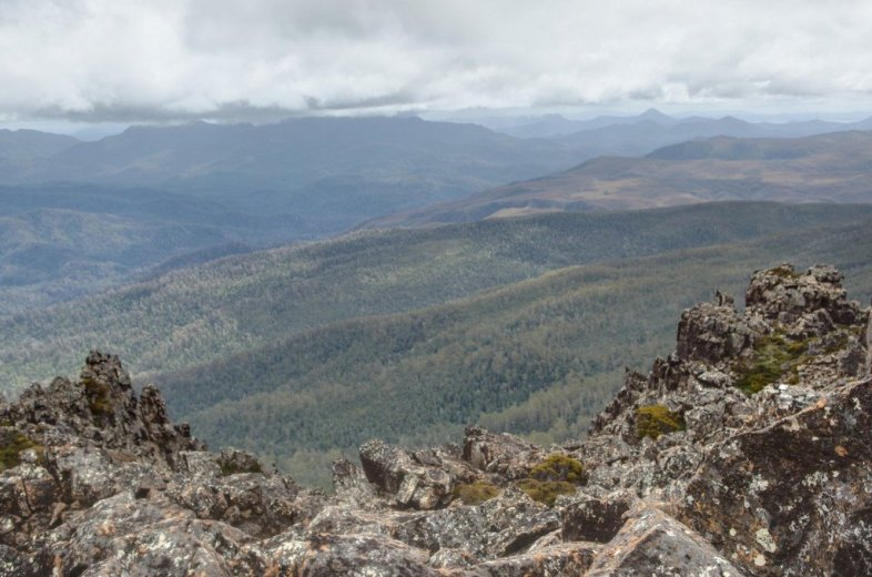 Looking west toward Mt Anne from the Snowy Range - by Angus Munro