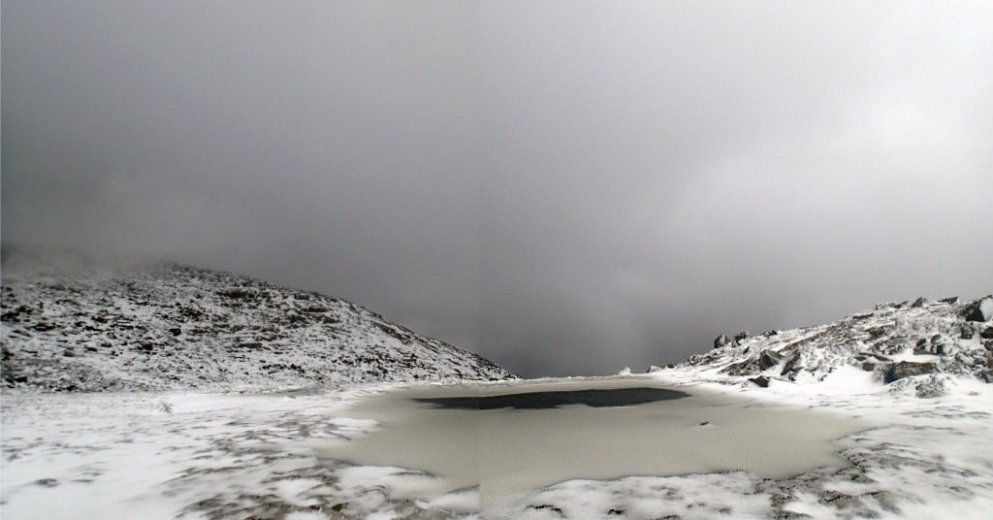 Frozen tarn on the Mt Anne plateau - by Chris Coxson