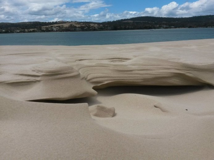A tiny and temporary sculpture of sand - At Five Mile Beach