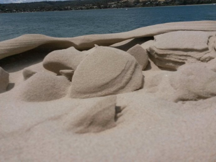 The sculptured crest breaks apart on the sand dune - At Five Mile Beach