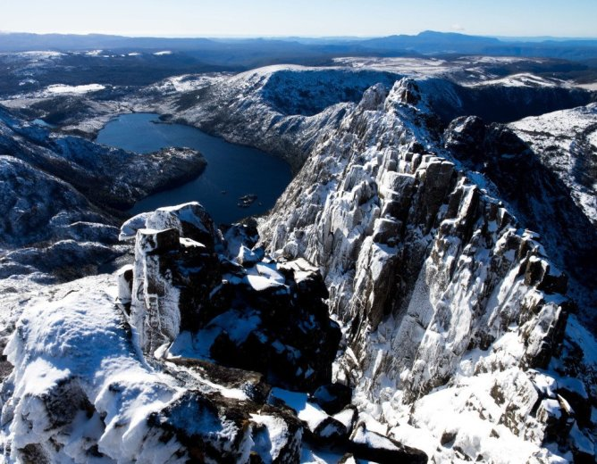 The spine of Cradle Mountain, after a snow storm. Taken while attempting the Cradle Skyline Traverse. Dove Lake below- by Andy Szollosiundefined