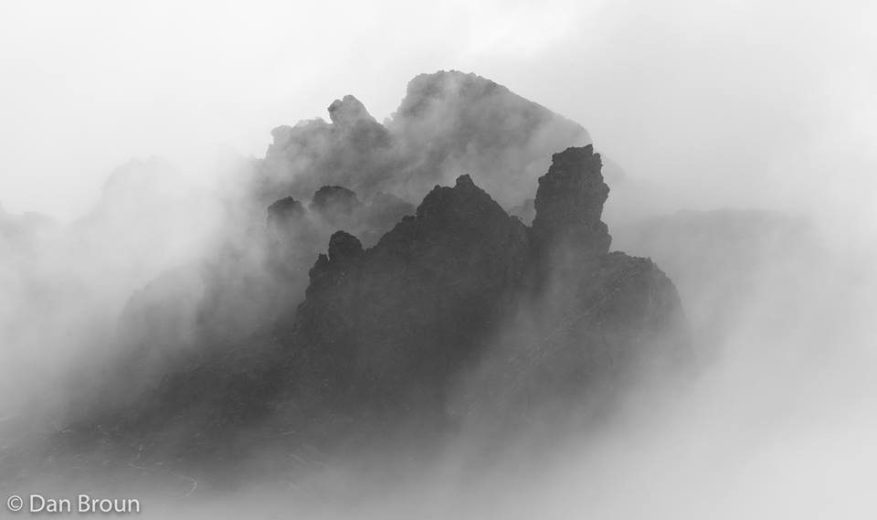 The crags and spires over Hanging Lake watch while mist and fog dance and swim and push and pull- by Dan Broun