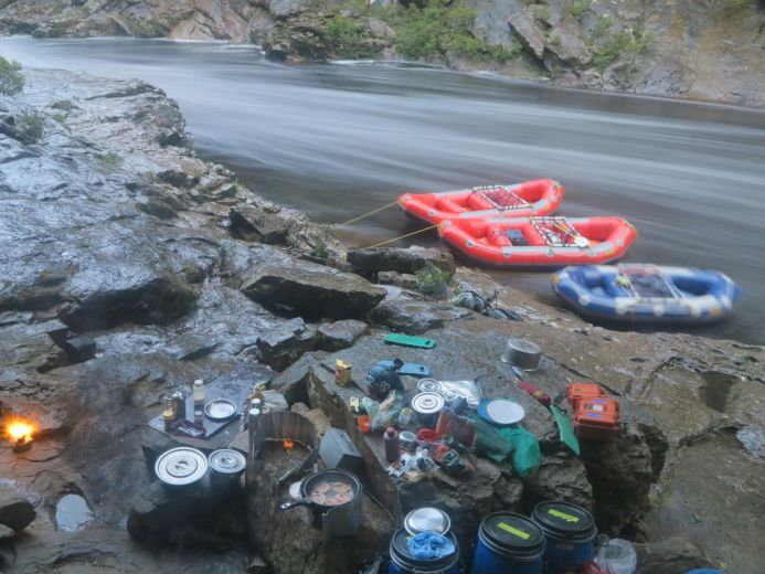 A campsite dinner above the river