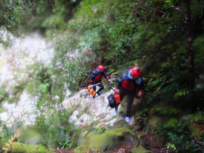 Carrying our equipment over cliffs to avoid the rapids