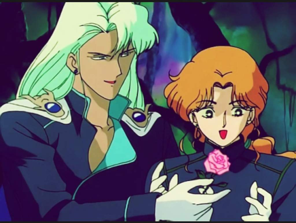 Malachite leaning over and hands a happy Zoisite a pink rose.