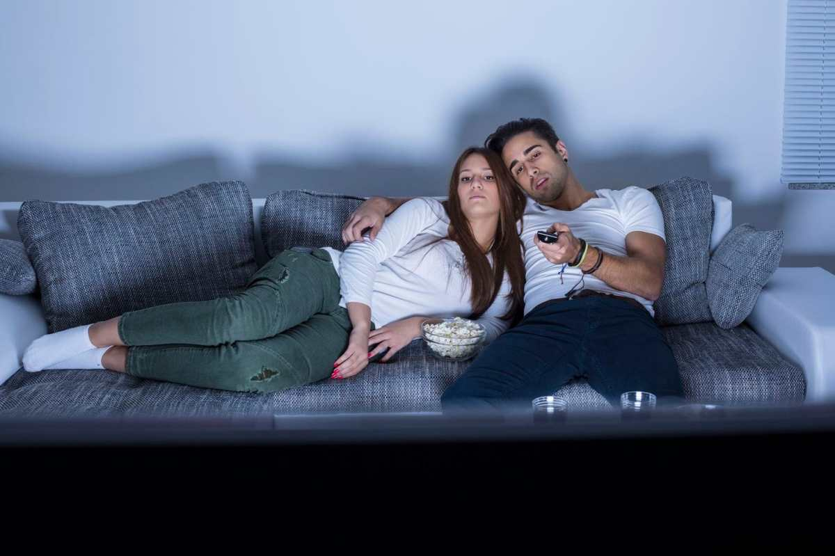 A couple watching a television series.