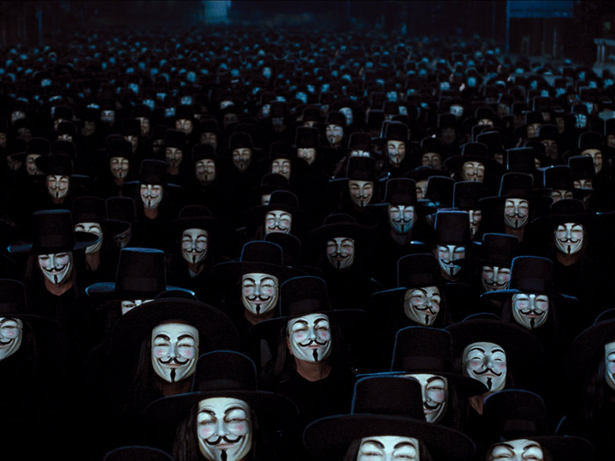 The crowd the masked character V inspired. The crowd is wearing Guy Fawkes masks.