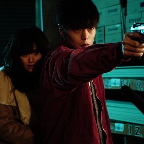 First Love: Leo protects Monica with a gun.
