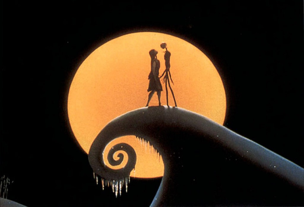 Jack and Sally singing on a mountain top at night.