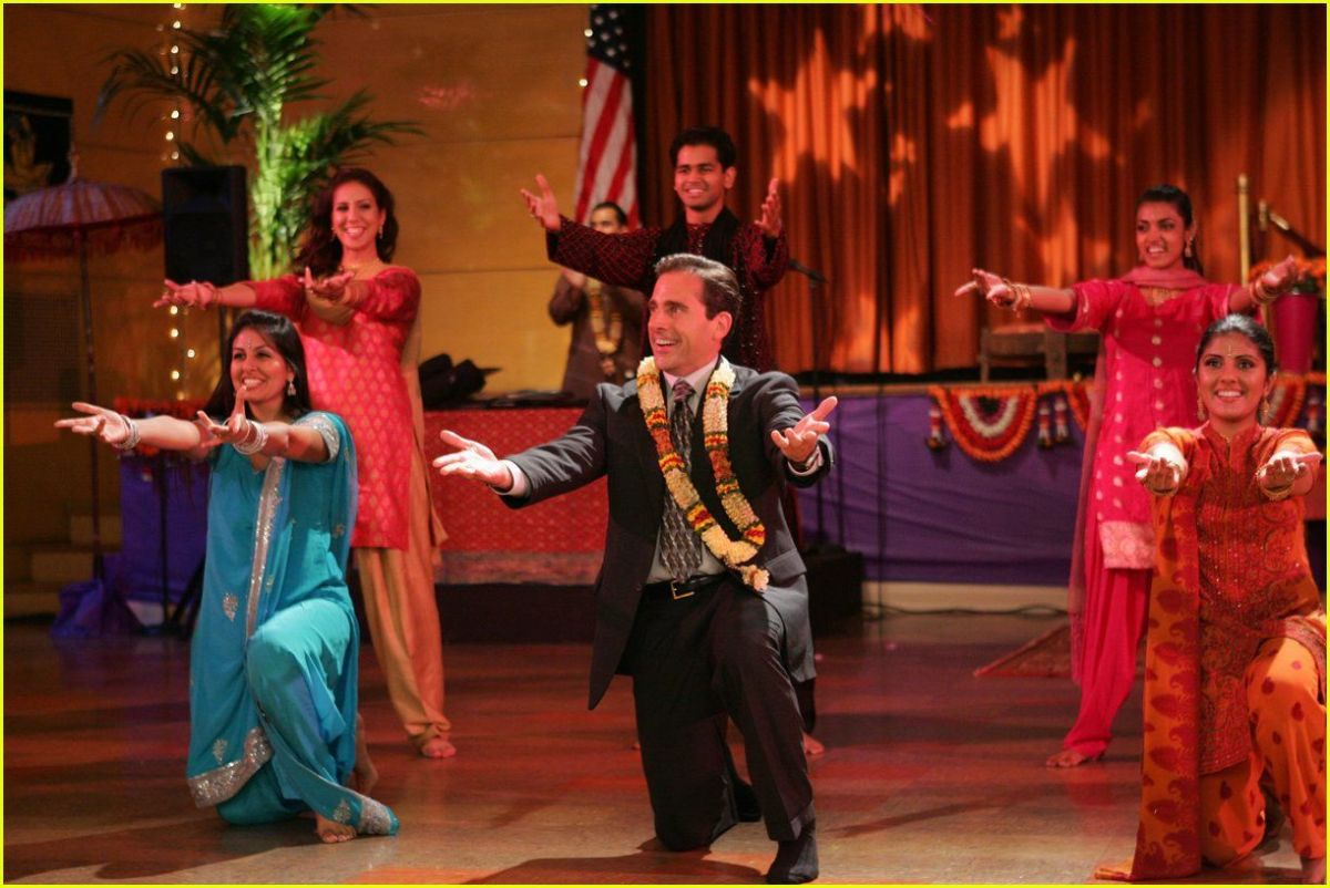 Micheal Scott celebrating Diwali by dancing along with the Hindu community.