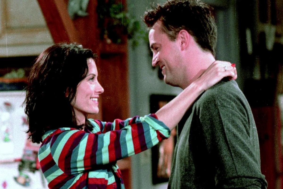 Monica and Chandler sharing a cute moment in their apartment