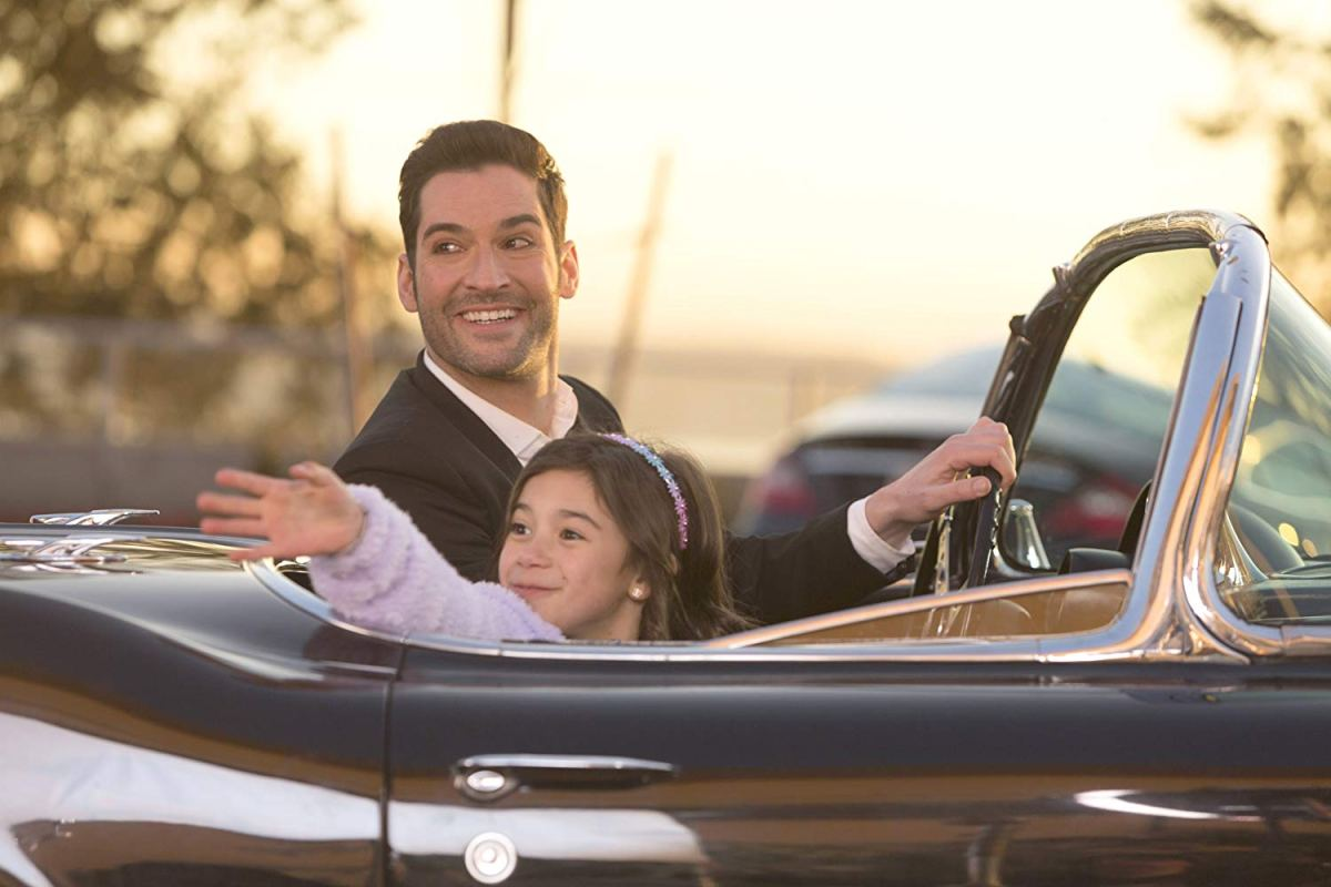 Lucifer Morningstar drives a car with Trixie Decker in the passenger seat.